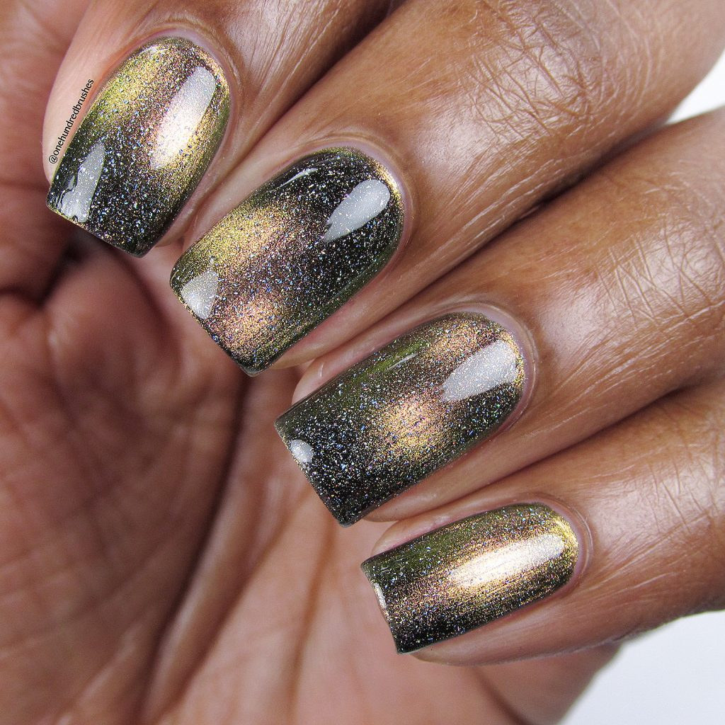 Let's do Launch with Star is Formed holographic topcoat, closeup, KB Shimmer, magnetic polish